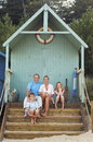 Vacationing family sitting in beach hut portrait of a together Royalty Free Stock Photography