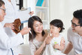 Vaccination child family doctor vaccines or injection to baby girl pediatrician and patient Stock Photo