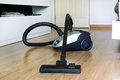 Vacuum cleaner on the floor Stock Photography