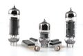 Vacuum radio tubes and semiconductor chips over white Stock Images
