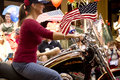 Vail Fourth of July Parade; Woman Riding a Harley Royalty Free Stock Photo