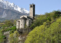 Valcamonica san siro abbey view with alps on background the church of is located on a narrow ledge overlooking the river Stock Image