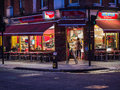 Valencia cafe bloomsbury london on a winter night lights inside busy spill out onto sidewalk at corner of marchmont street and Stock Photos