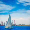 Valencia city port with sailboat and cranes in background at spain Royalty Free Stock Photos