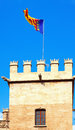 Valencia flag at top of lonja de la seda valencia flying spain Stock Photography