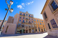 Valencia plaza almoina modernist spain punt de ganxo building rear cathedral at Stock Photo