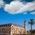 Valencia port building with tower and palm tree in mediterranean spain Stock Image