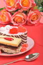 Valentine cakes, tarts and red roses on the red tablecloth Royalty Free Stock Images
