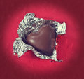 Valentine candy heart chocolate on red background vintage style Stock Image