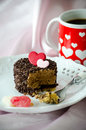 Valentine cappuccino cake and coffee a small delicious coated with chocolate chips decorated with a pink red heart made from Stock Image