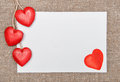 Valentine card with drawing heart and wooden hearts on burlap background Stock Images