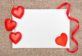 Valentine card with drawing heart and wooden hearts on burlap background Stock Photo