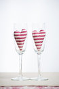 Valentine concept champagne glasses with hearts two stripped in Royalty Free Stock Photos