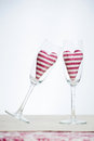 Valentine concept champagne glasses with hearts two stripped in Stock Images