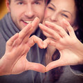 Valentine couple making shape of heart by their hands Stock Photos
