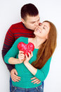 Valentine couple portrait of smiling beauty girl and her handsome boyfriend love concept heart sign happy lovers valentines d Stock Image