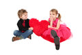 Valentine couple young boy and girl holding a heart Stock Image