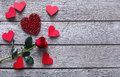 Valentine day background, hearts and rose flower on wood