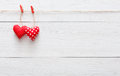 Valentine day background, pillow hearts border on wood, copy space Royalty Free Stock Photo
