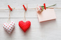 Valentine day background, pillow hearts and card on wood