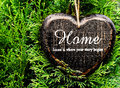 Valentine day card concept heart shaped decor sign desk home co country style on green fir tree background Stock Photo