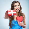Valentine day concept woman hold red heart gift box studio background female model Stock Images