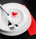 Valentine day dinner with table setting in red and elegant heart ornaments restaurant series holiday Stock Photos