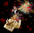 Valentine day glamour man in classical smoking with holidays gift golden box Royalty Free Stock Photography
