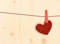 Valentine day series decorative red heart hanging on wood background with space for text Stock Image