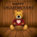 Valentine day teddy bear brown stuffed toy print on chest wooden background Stock Photo