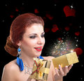 Valentine day young beautiful girl with golden gift box Stock Photo