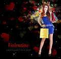 Valentine day young beautiful happy girl with gifts in Stock Photography