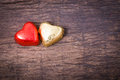 Valentine decoration couple heart shaped chocolate red and gold golden on wooden table top Stock Photo