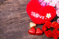 Valentine decoration heart shaped chocolate roses heart and l love word on wooden table top Stock Photos
