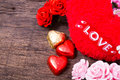 Valentine decoration heart shaped chocolate roses heart and l love word on wooden table top Royalty Free Stock Photos