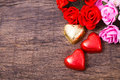 Valentine decoration heart shaped chocolate and roses on wooden table top Stock Image