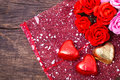 Valentine decoration heart shaped chocolate and roses on wooden table top Stock Photography