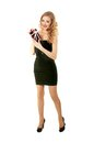 Valentine elegant girl beautiful standing with gift in black dress Royalty Free Stock Photography