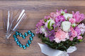 Valentine flowers on with heartshaped jewellery Royalty Free Stock Photo