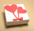 Valentine gift on a beige background Stock Images