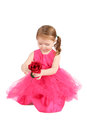 Valentine girl holding a red rose wearing pink Royalty Free Stock Photo