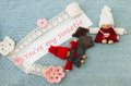 Valentine greeting card with pink hearts flowers chokolate an and red and knitting couple in love lettering you're my sweetie on Royalty Free Stock Image