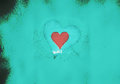 Valentine heart on a light blue grunge background Stock Image