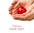 Valentine heart in man and woman hands isolated on white Royalty Free Stock Photo