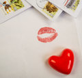 Valentine heart red lies on a background of open letters and envelopes Royalty Free Stock Photos