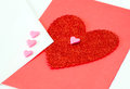 Valentine heart in red and pink hearts on white with a white envelope Royalty Free Stock Images