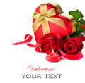 Valentine heart shape gift box and red roses bouquet Royalty Free Stock Images