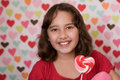 Valentine lollipop and girl Royalty Free Stock Photos