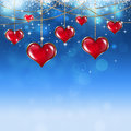 Valentine red hearts on soft blue background with stars and blurry lights Royalty Free Stock Image