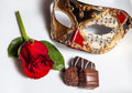 Valentine romance red rose chocolate and mask create mystery and Stock Photography